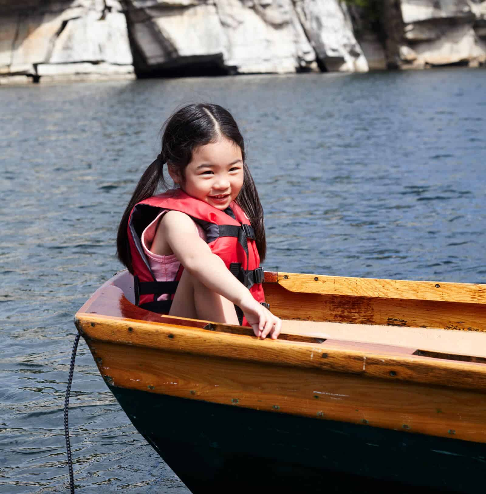 Young girl in row boat