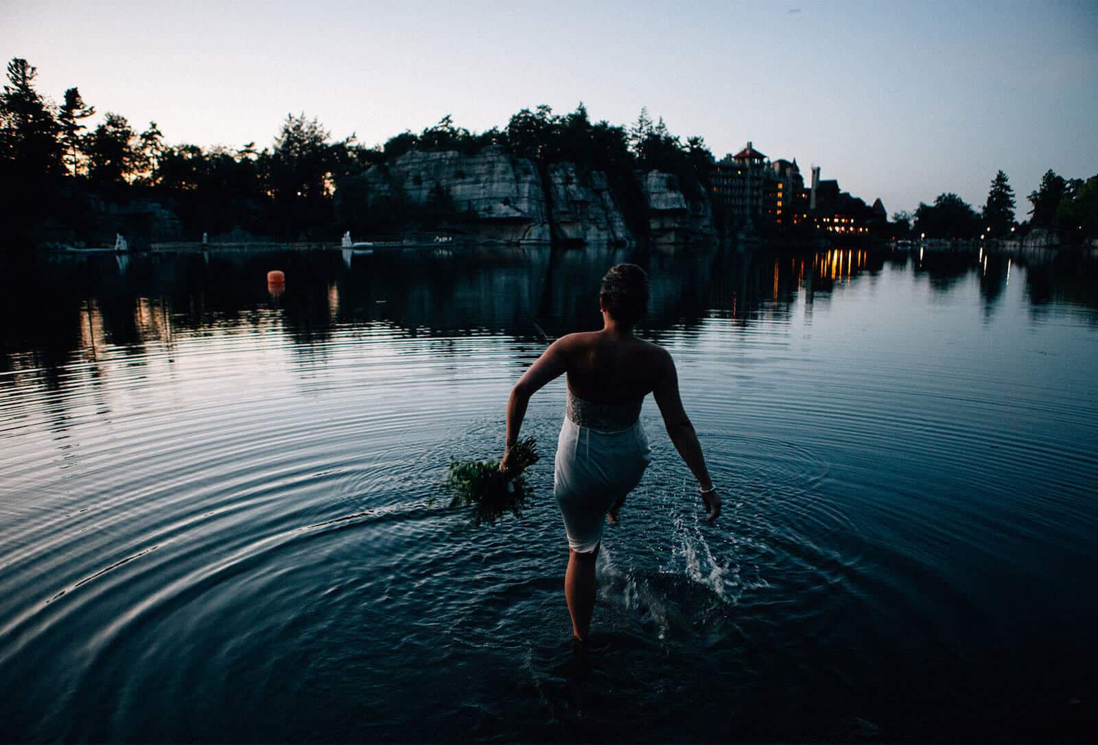 Bride jumping into Mohonk Lake