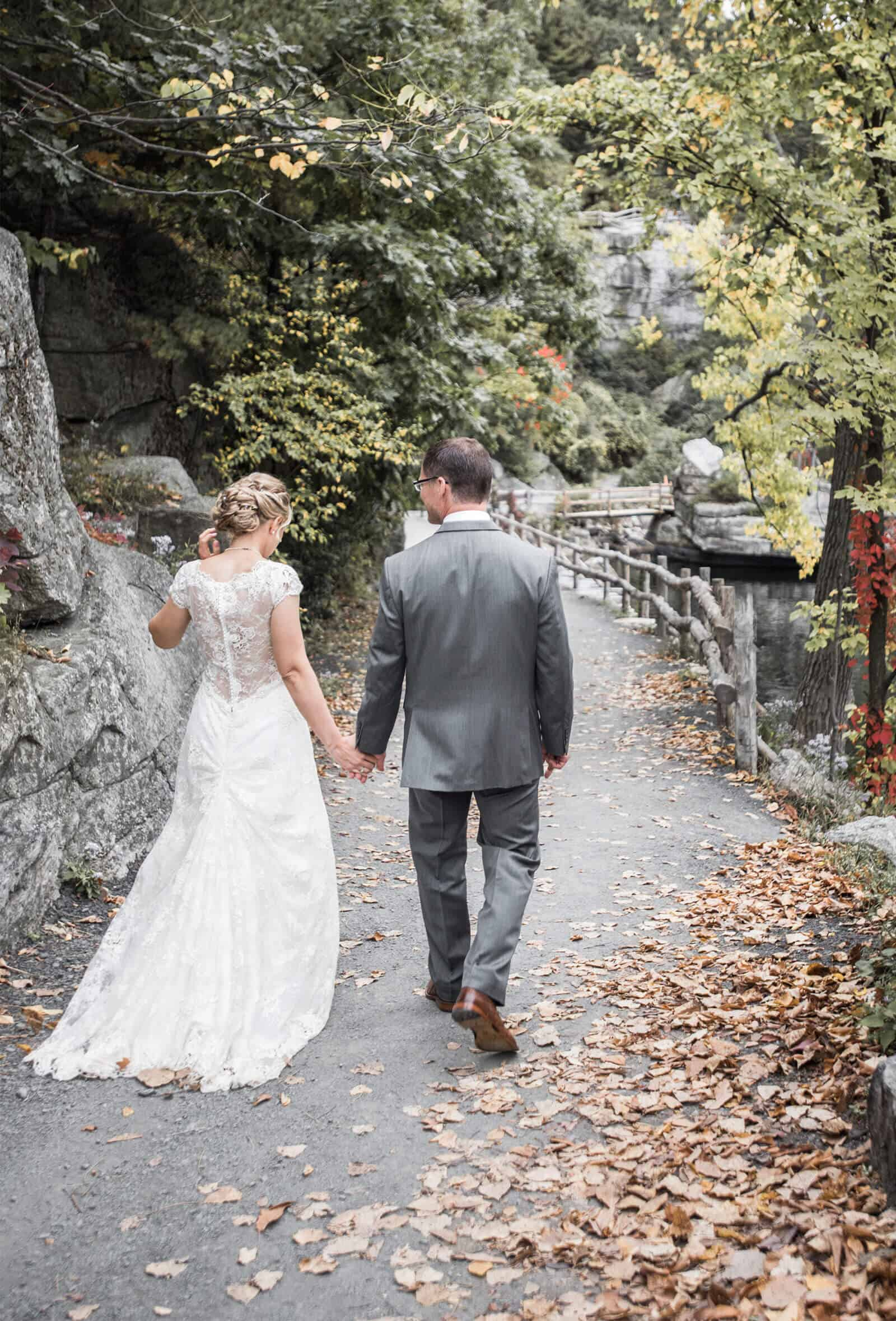 Bride and groom walking on trail