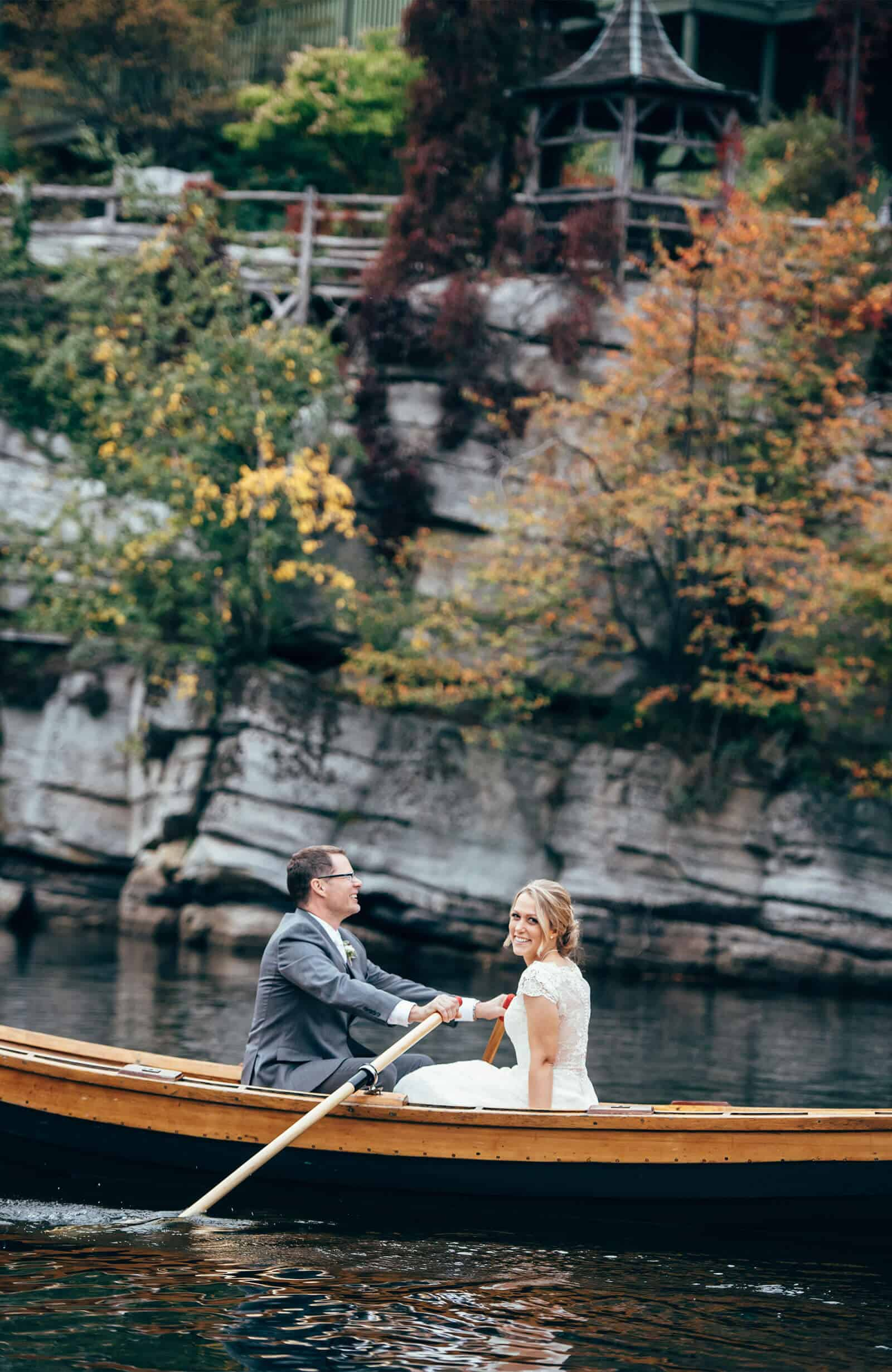 Bride and groom in Canoe on Mohonk lake