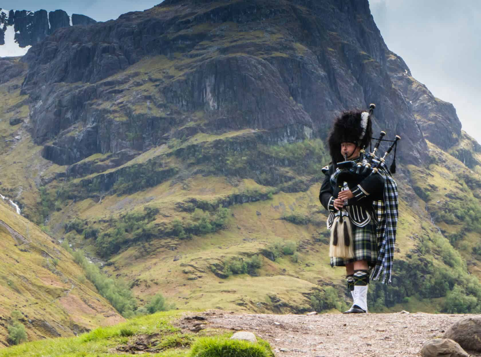 Scottish performer in mountains