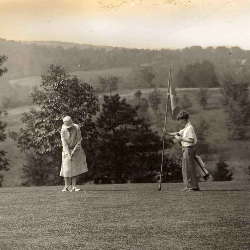 Lady Playing Golf with Caddy 1920s