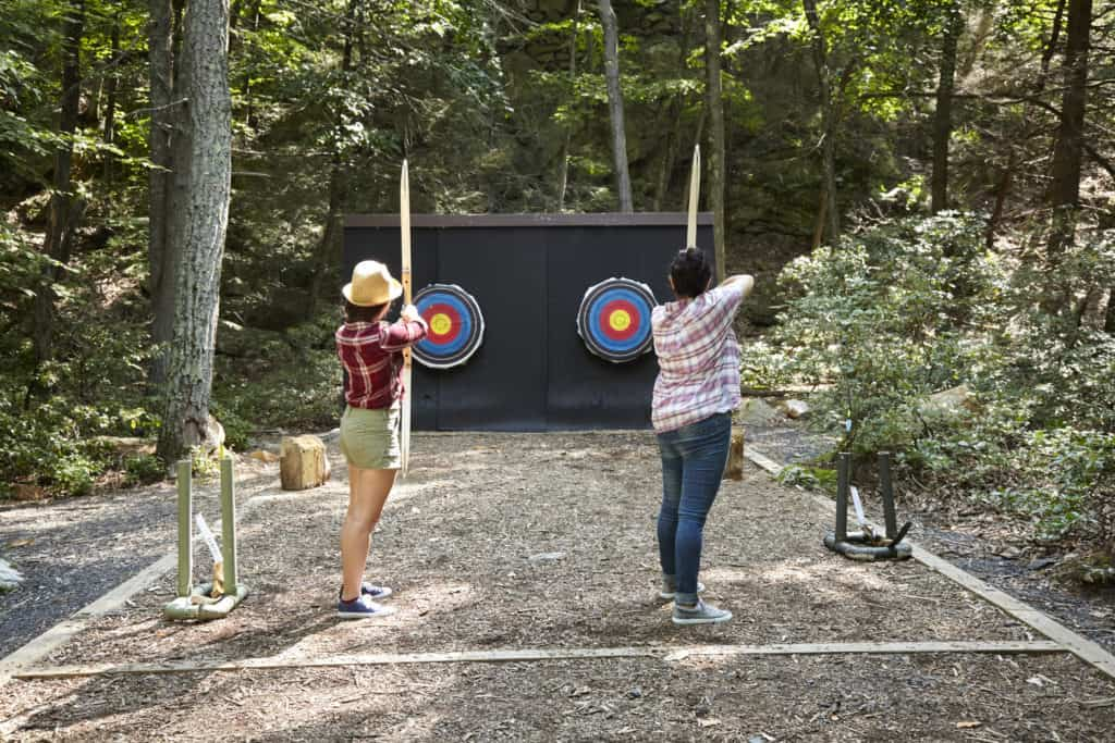 Two women doing archery