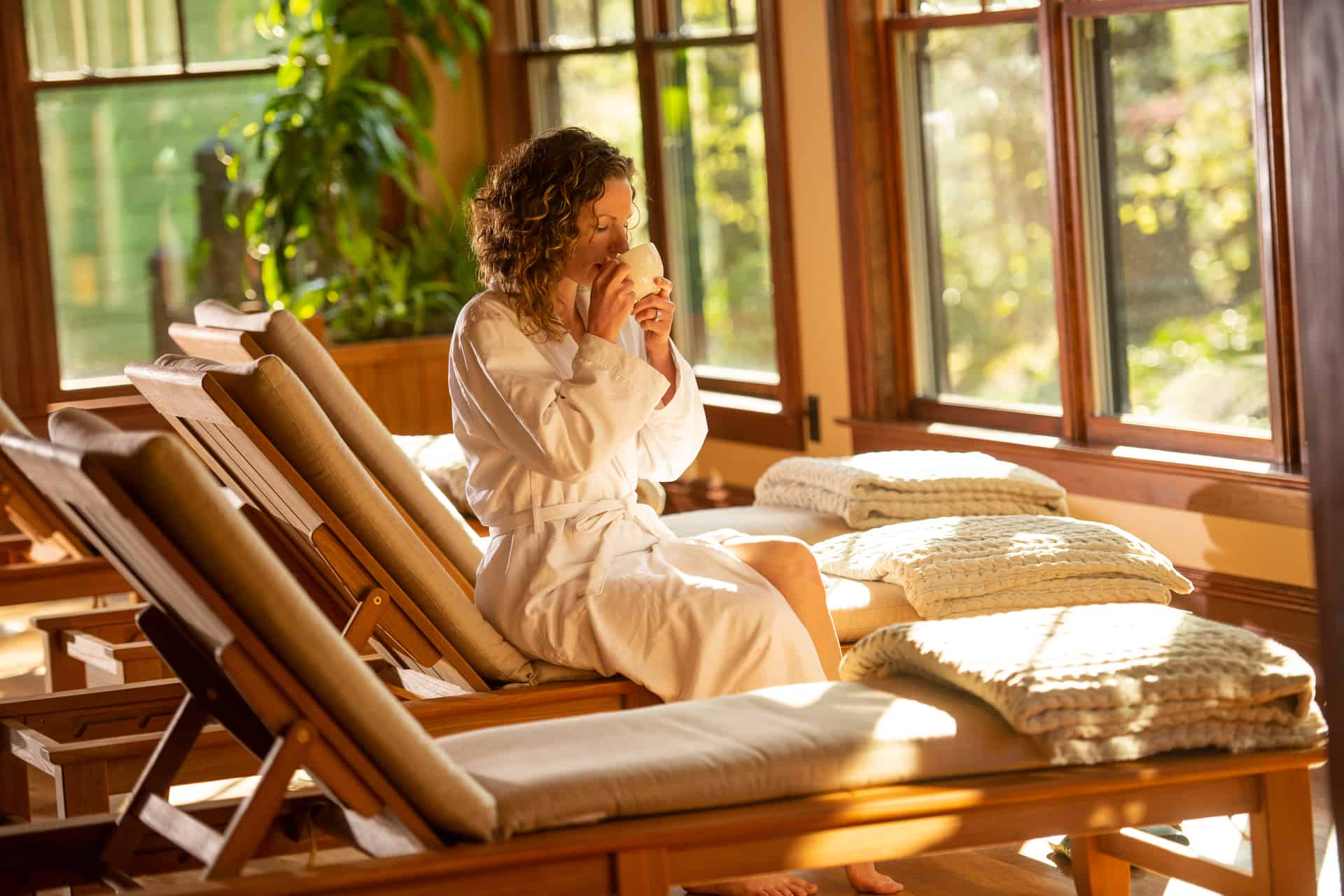 Woman sitting in spa veranda