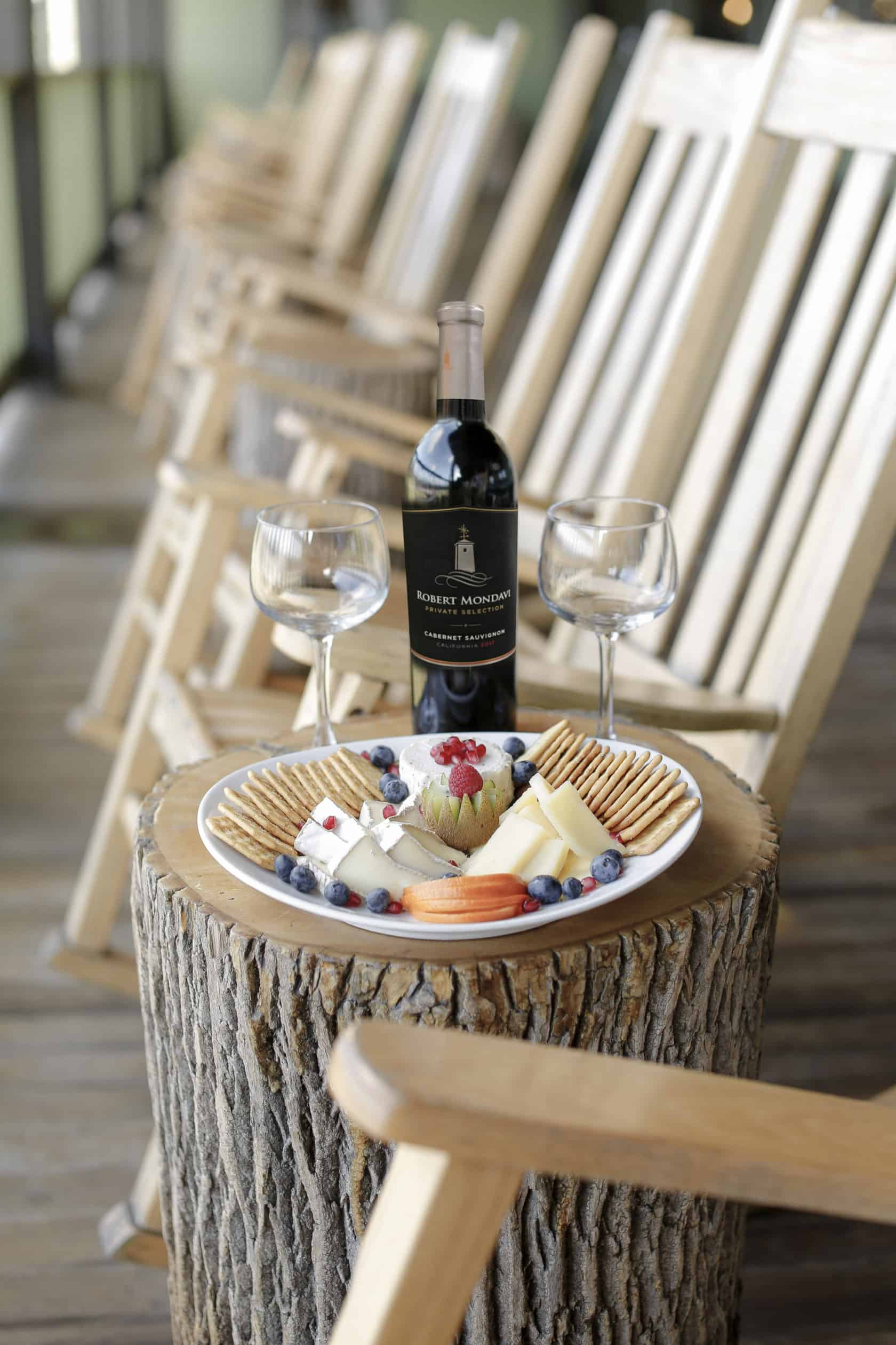 wine and cheese plate by rocking chairs