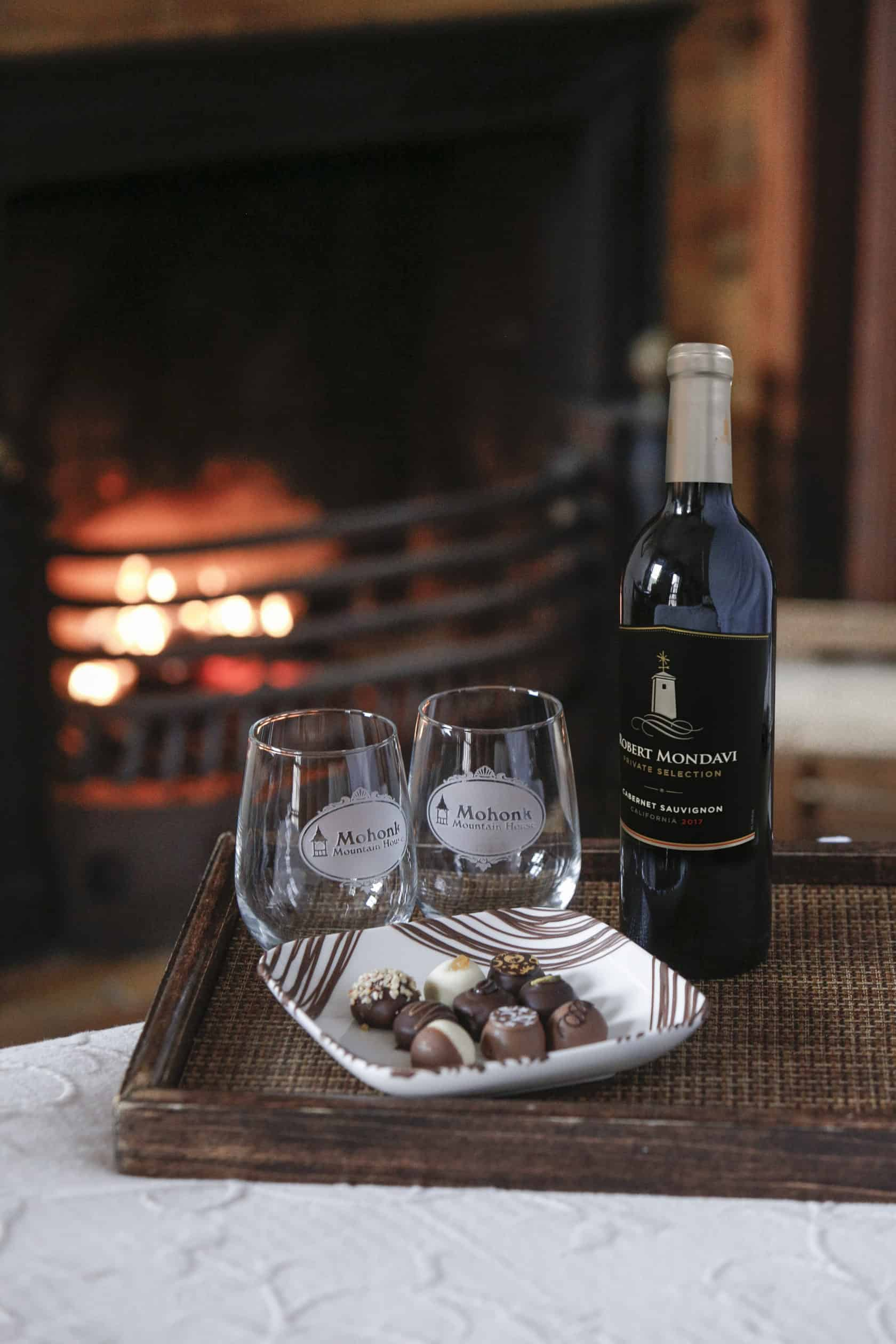 chocolates and wine by fireplace